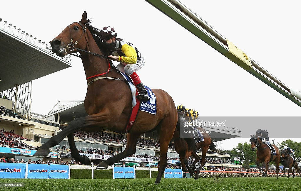 Craig Williams riding Precedence crosses the line to win the Drake International Cup during Cox Plate Day at Moonee Valley Racecourse on October 26, 2013 in Melbourne, Australia.