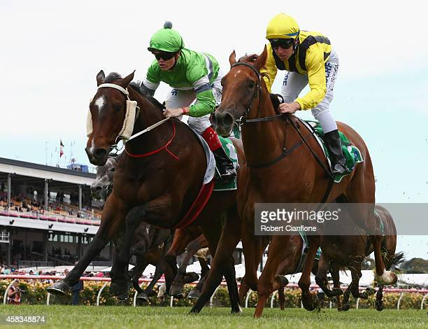 Craig Williams riding Precious Gem gets ahead of ahead of Tommy Berry riding Amanpour to win race two the tabcomau trophy on Melbourne Cup Day at...