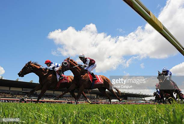 Craig Williams riding Redkirk Warrior defeats Brad Rawiller riding Stratum Star in Race 2 Yarramalong Racong Club Stakes during Melbourne Racing at...