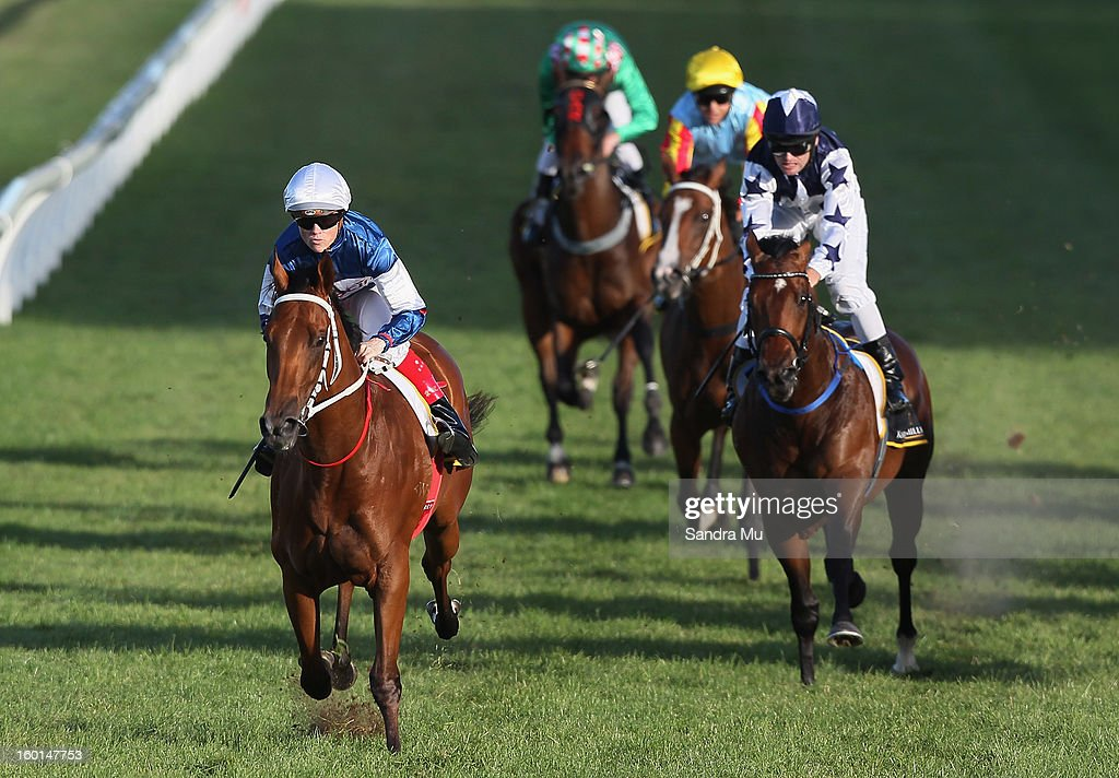 Craig Williams riding Ruud Awakening (L) leads the pack to win the Karaka Million in race four during the Karaka Million at Ellerslie Racecourse on January 27, 2013 in Auckland, New Zealand.