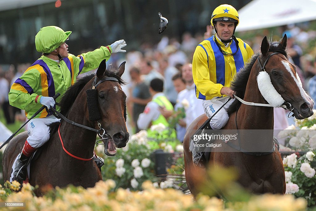 Craig Williams riding Star of Giselle throws his goggles in the crowd after the Super Saturday Stakes during Super Saturday at Flemington Racecourse on March 9, 2013 in Melbourne, Australia.