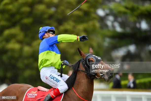 Craig Williams throws his whip into the crowd after riding Fuhryk to win the Carlton Draught Alinghi Stakes at Caulfield Racecourse on October 21...