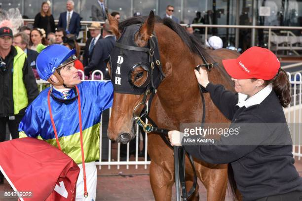 Craig Williams with Fuhryk after winning the Carlton Draught Alinghi Stakes at Caulfield Racecourse on October 21 2017 in Caulfield Australia