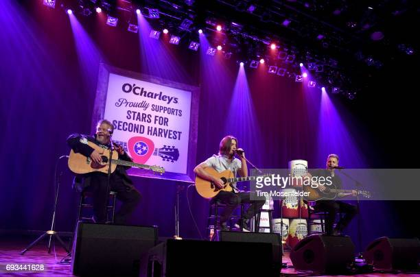 Craig Wiseman Brad Warren and Brett Warren of The Warren Brothers perform during the 13th Annual Stars for Second Harvest benefit at Ryman Auditorium...