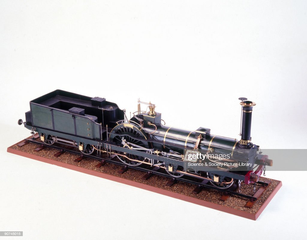 Crampton Locomotive, 1849. Model (scale 3:20). This locomotive was designed by T R Crampton for the Northern Railway of France, and was of the engine type patented by him during the period 1842-47. The distinctive position of the boiler kept the centre of gravity low, which added stability at speed. Locomotives of this design hauled French expresses from 1849 to about 1876. Built by M M Derosne et Cail, of Paris.