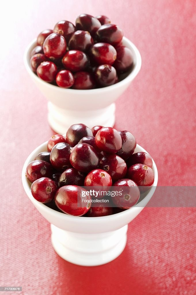 Cranberries in two small bowls : Stock Photo
