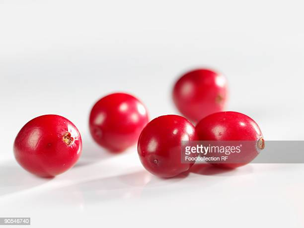 Cranberries on white background, close up