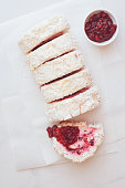 Cranberry meringue roulade with cranberry sauce. Top view, vintage toned image, blank space