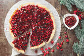 Delicious cranberry tart with jellied and fresh cranberries for Christmas. Top view, vintage toned