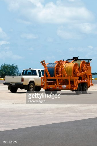 Crane and a car at a commercial dock : Stock Photo