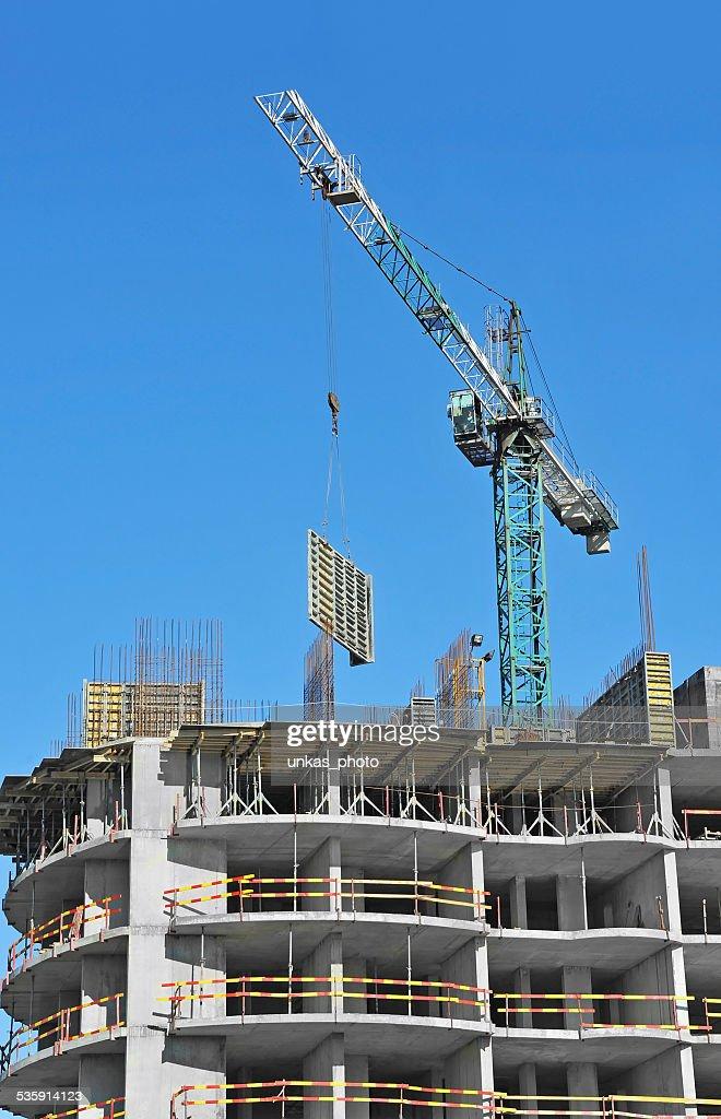 Crane and construction site : Stock Photo
