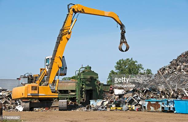 Crane and metal compactor at recycling facility
