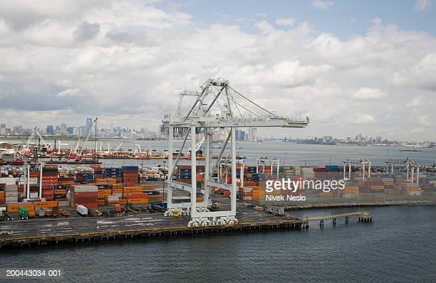Crane and storage containers on pier, elevated view