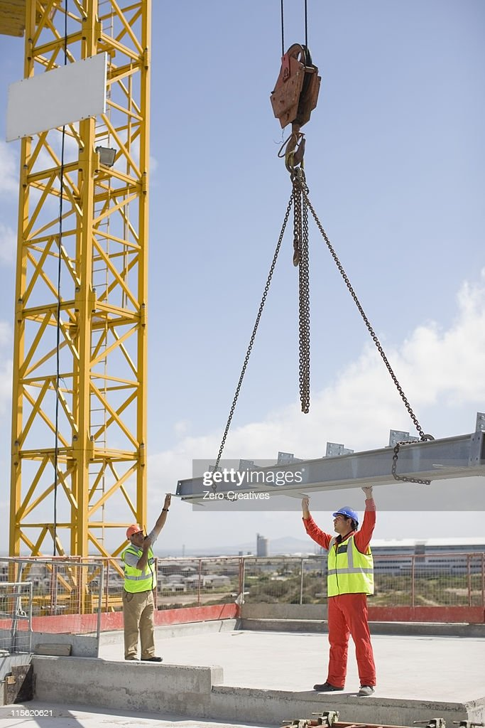 Crane and workers on construction site