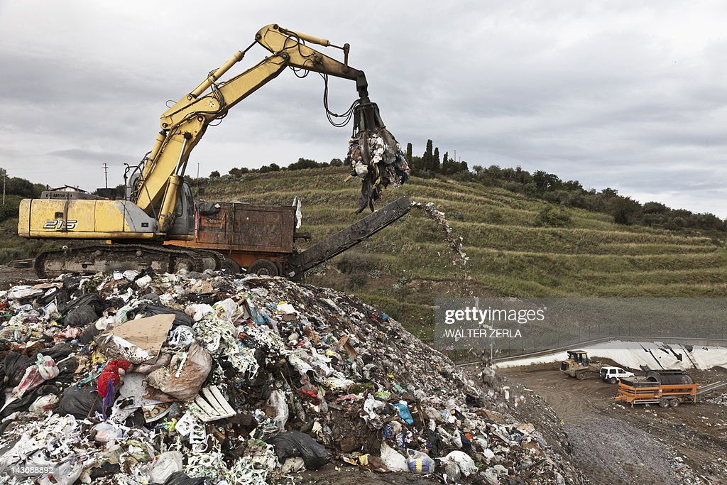 Crane at garbage collection center : Stock Photo