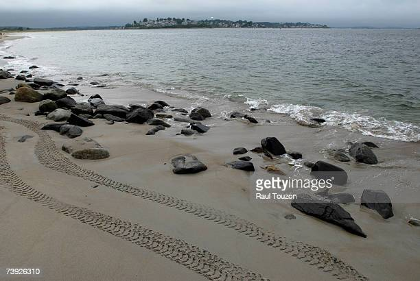NORTH AMERICA,UNITED STATES,NEW ENGLAND STATES,MASSACHUSETTS,CRANE BEACH,TRACKS,VEHICULAR TRACKS,BEACHES,SAND,SHORELINES,SCENIC VIEWS,ROCK,IPSWICH,NATURAL FORCES AND PHENOMENA,WEATHER,STORMS,COLOR IMAGE,HORIZONTAL
