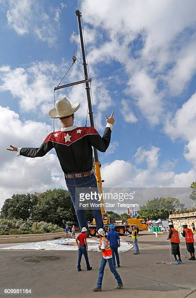 A crane begins to lift Big Tex into place with the State Fair of Texas one week away from opening at the Midway in Dallas on Friday Sept 23 2016