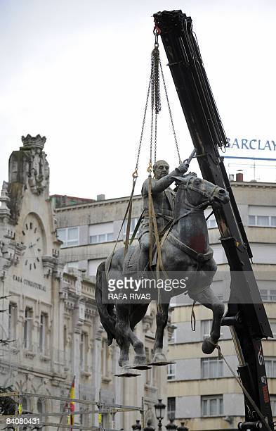 A crane dismantles the last Spanish dictator Francisco Franco's equestrian statue on December 18 2008 in the northern Spanish city of Santander...
