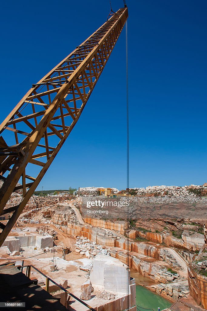 A crane hangs over a marble quarry pit operated by Bloco B in Bencatel, Vila Vicosa, Portugal, on Wednesday, April 17, 2013. Portugal is posting its first trade surplus in at least six decades, which may help vindicate a strategy of front-loading austerity to deliver economic reform. Photographer: Mario Proenca/Bloomberg via Getty Images