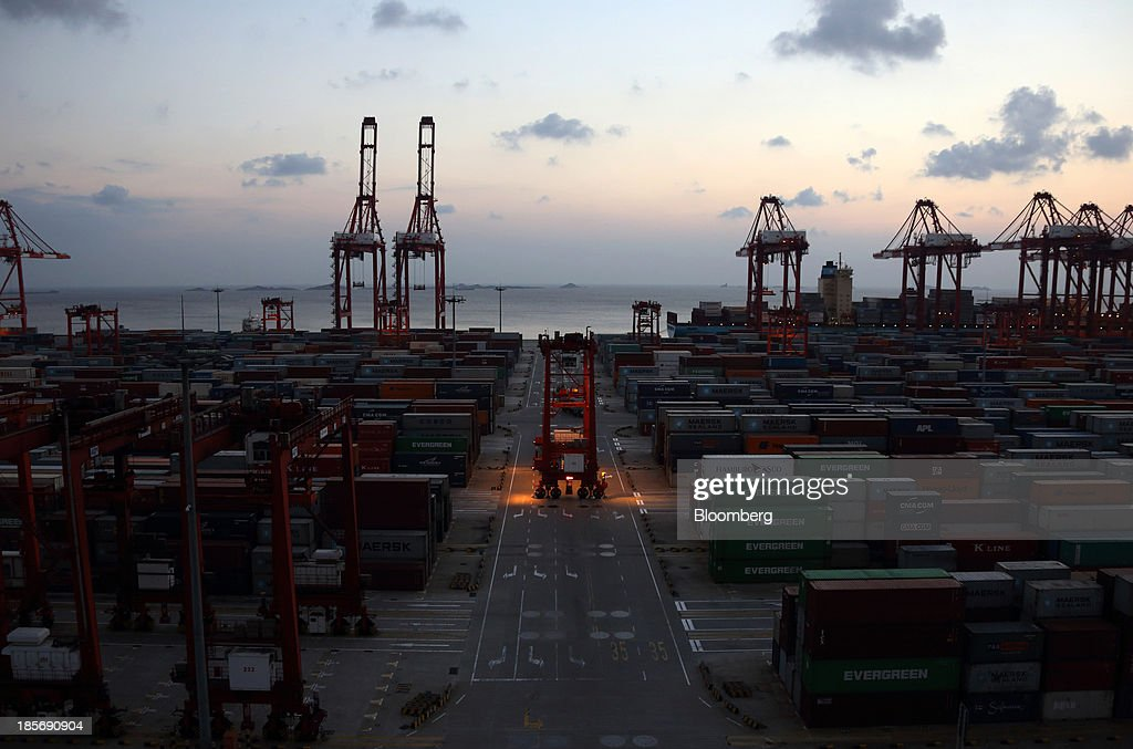 A crane is moved through the Yangshan Deep Water Port, part of China (Shanghai) Pilot Free Trade Zone's Yangshan free trade port area, in Shanghai, China, on Wednesday, Oct. 23, 2013. The area is a testing ground for free-market policies that Premier Li Keqiang has signaled he may later implement more broadly in the world's second-largest economy. Photographer: Tomohiro Ohsumi/Bloomberg via Getty Images