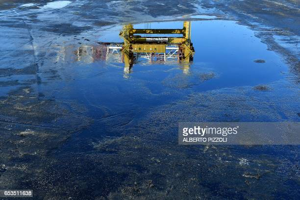 A crane is reflected in water on the quayside of French sugar cooperative Cristal Union's commercial dock after sugar was unloaded at the SFIR...