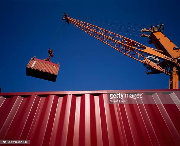 Crane lifting a cargo container.
