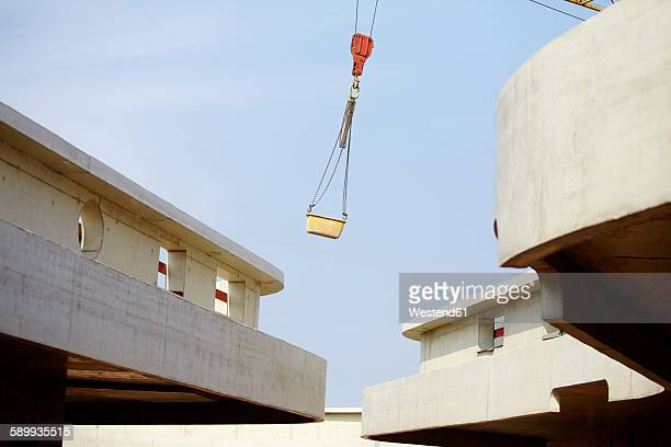 Crane lifting container on construction site