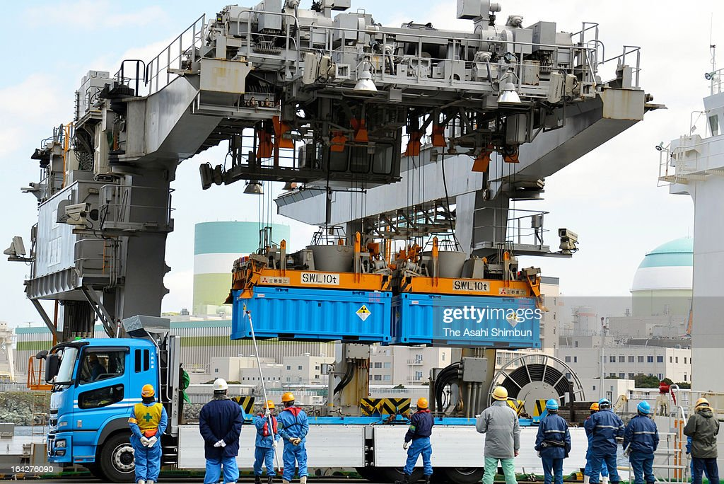 A crane lifts containers of radioactive waste and loads onto a cargo ship in Shikoku Electric Power Co Ikata Nuclear Power Plant on March 21, 2013 in Ikata, Ehime, Japan. The waste is going to be shipped to Rokkasho village, Aomori, Japan.