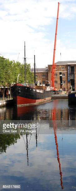 A crane lifts the funnel of the SS Robin in preparation for a refit of the ship