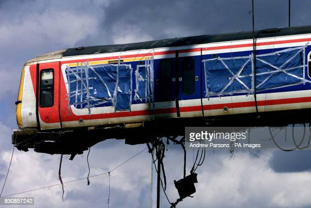 A crane lifts the train carriage from where it was lying across two platforms at Potters Bar station north of London The lift had been planned for...