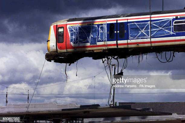 A crane lifts the train carriage over the roof from where it was lying across two platforms at Potters Bar station north of London The lift had been...