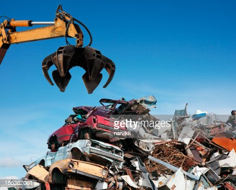 Crane loader taking scrap iron