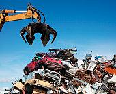 Crane loader taking scrap iron