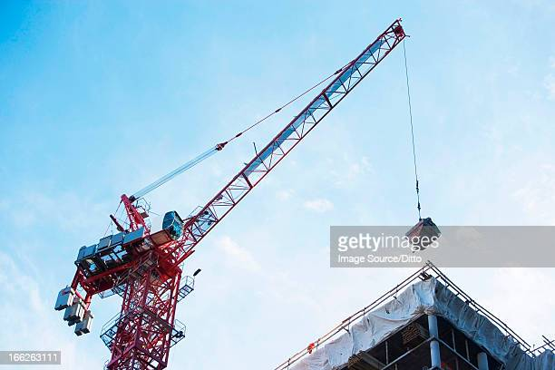 Crane loading equipment on building