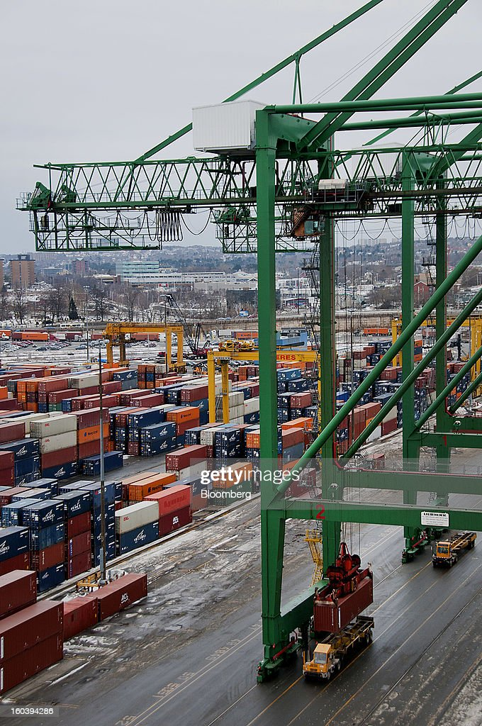 A crane loads a freight container onto a truck for transport at the Port Of Halifax's Fairview Cove container terminal, operated by Cerescorp Co., in Halifax, Nova Scotia, Canada, on Wednesday, Jan. 30, 2013. Statistics Canada (STCA) is scheduled to release gross domestic product data on Jan. 31. Photographer: Aaron McKenzie Fraser/Bloomberg via Getty Images