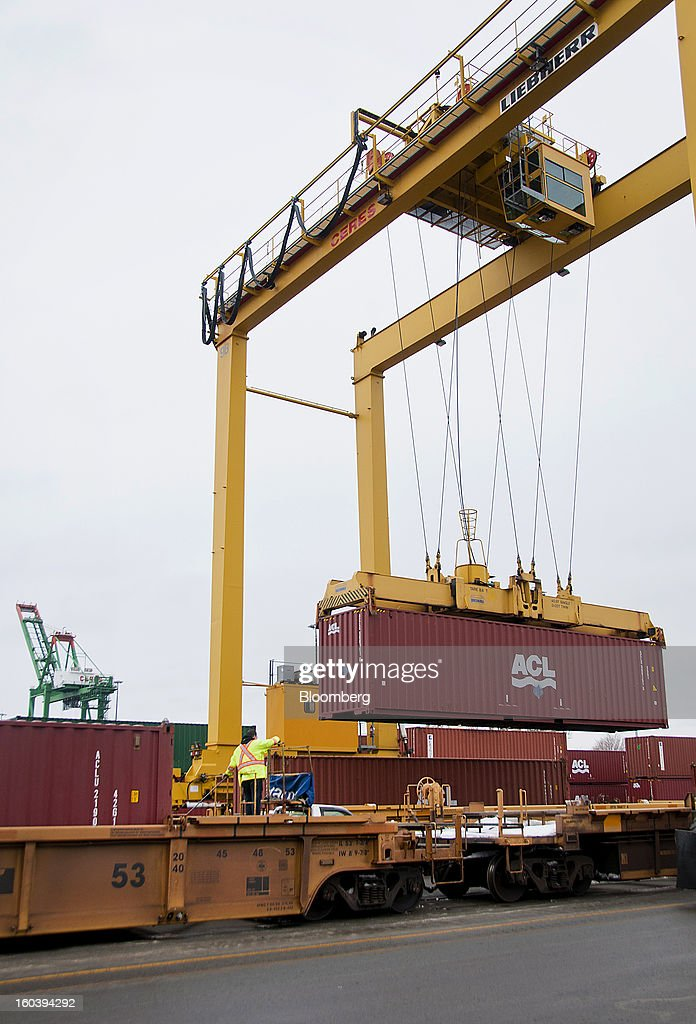 A crane loads an Atlantic Container Line (ACL) freight container from a ship docked at the Port Of Halifax's Fairview Cove container terminal, operated by Cerescorp Co., in Halifax, Nova Scotia, Canada, on Wednesday, Jan. 30, 2013. Statistics Canada (STCA) is scheduled to release gross domestic product data on Jan. 31. Photographer: Aaron McKenzie Fraser/Bloomberg via Getty Images