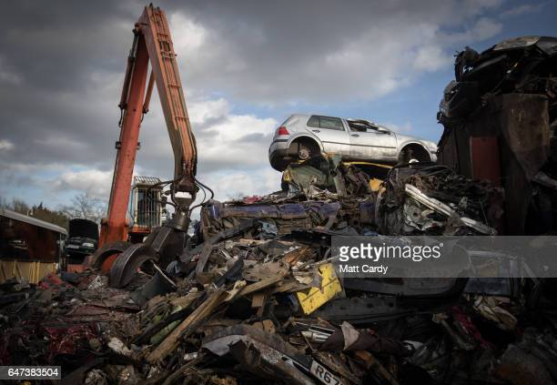 A crane loads scrap metal and cars onto a lorry at Pylle Motor Spares and Metal Processing a licensed scrap yard in Pylle near Shepton Mallet on...