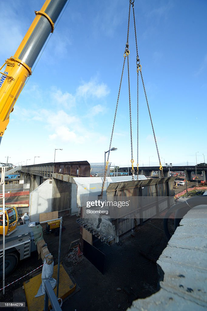A crane lowers a section of a footbridge removed for replacement at a John Holland Group construction site at North Melbourne railway station in...