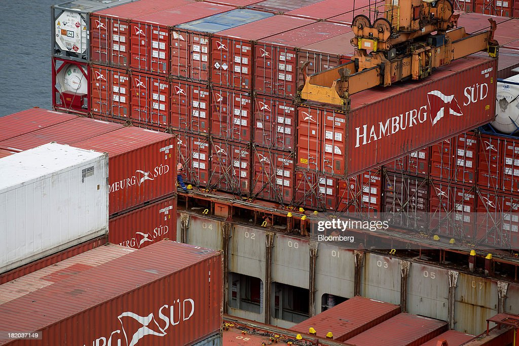 A crane lowers a shipping container at the Port of Veracruz in Veracruz, Mexico, on Thursday, Sept. 26 2013. Mexico reported a preliminary trade deficit of $234.2 Million for August, according to the national statistics agency, known as Inegi. Photographer: Susana Gonzalez/Bloomberg via Getty Images