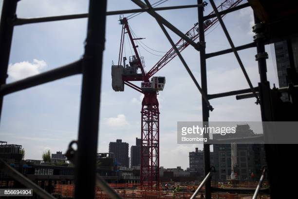 A crane operates on top of the 420 Kent Avenue apartment development during construction in the Williamsburg neighborhood of the Brooklyn borough of...