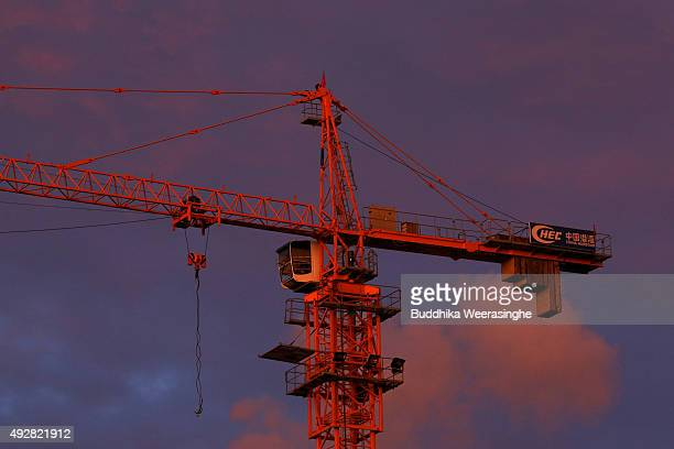 A crane seen sunset light at a construction site at the hotel complex construct by Chinese company on October 15 2015 in Colombo Sri Lanka Sri Lankan...