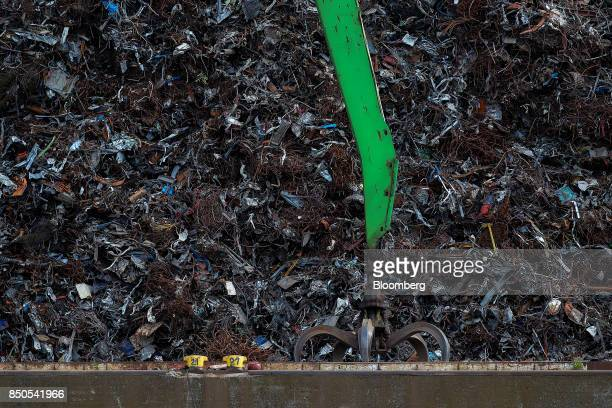 A crane shifts scrap metal at the Altenwerder container terminal at the Port of Hamburg in Hamburg Germany on Wednesday Sept 20 2017 Germany's...