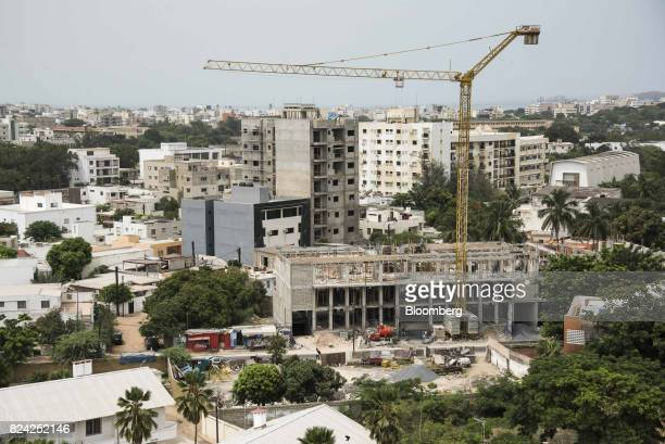 A crane stands above a building under construction in the Point E district in Dakar Senegal on Saturday July 29 2017 Senegalese voters will elect a...
