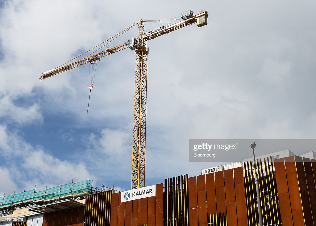 A crane stands on a construction site in Auckland, New Zealand, on Monday, Aug. 12, 2013. New Zealand's growth rate is forecast to outpace Australia's for the next two years, helping stem an exodus that's resulted in the highest proportion of its people living overseas in the developed world after Ireland. Photographer: Brendon O'Hagan/Bloomberg via Getty Images