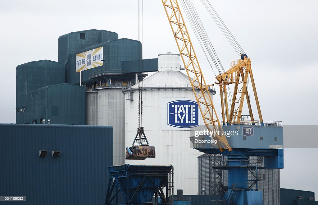 A crane stands on the unloading wharf at the Tate & Lyle Plc Thames Refinery, operated by American Sugar Holdings (ASR) Group, in London, U.K., on Wednesday, May 25, 2016. Tate & Lyle will report full year earnings on Thursday, May 26. Photographer: Chris Ratcliffe/Bloomberg via Getty Images