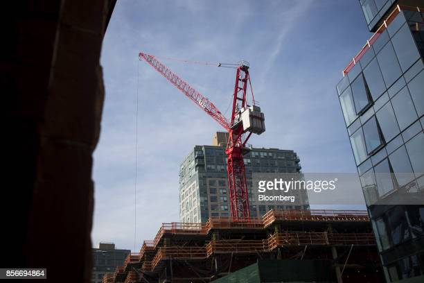 A crane stands on top of the 416 Kent Avenue apartment development under construction in the Williamsburg neighborhood of the Brooklyn borough of New...