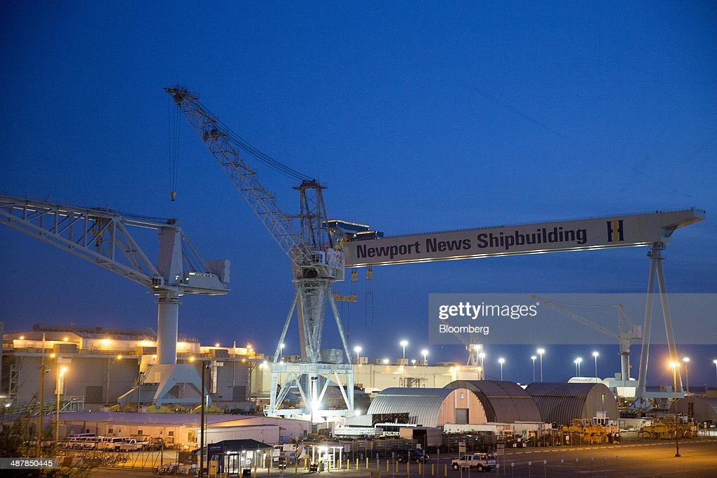 A crane stands over the Huntington Ingalls Industries' Newport News Shipbuilding shipyard in Newport News Virginia US on Sunday April 27 2014...
