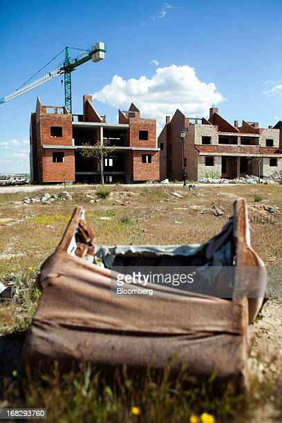 A crane stands over unfinished residential properties at a stalled construction site in Arroyomolinos Spain on Monday May 6 2013 Spain's efforts to...