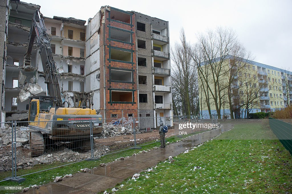 Apartment Building Association a crane tears down an apartment building from the gdr times in the