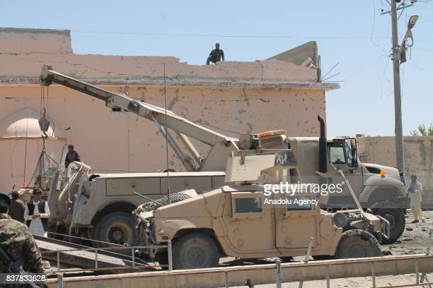 A crane truck picks up wrecked armored vehicles after a suicide attack which had conducted with a bombladen vehicle to a military convoy in...